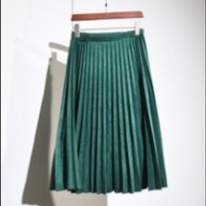 Green suede pleat skirt